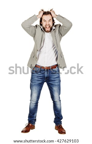 portrait of bearded business man tearing hair out in anger and looking at camera. human emotion expression and lifestyle concept. image on a white studio background. - stock photo