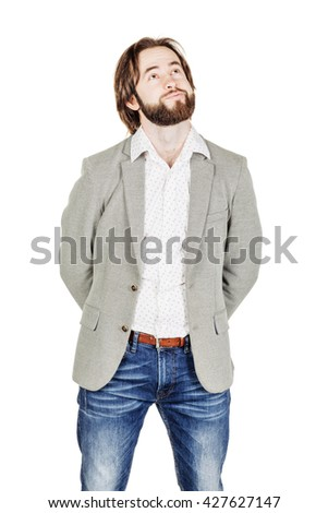 portrait of bearded man dreaming and looking up. human emotion expression and lifestyle concept. image on a white studio background. - stock photo