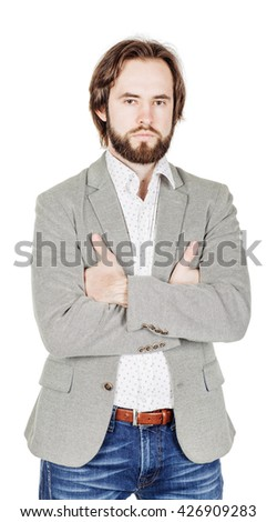 portrait of bearded man  looking at camera and keeping arms crossed. human emotion expression and lifestyle concept. image on a white studio background. - stock photo