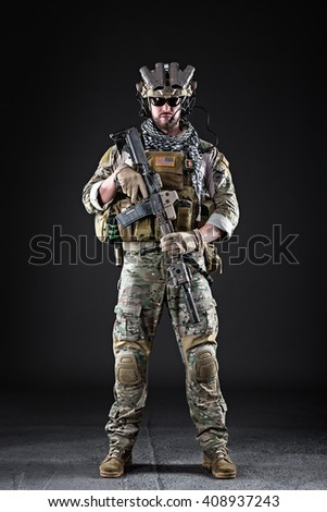 Portrait of Bearded US Army Soldier on Dark Background - stock photo