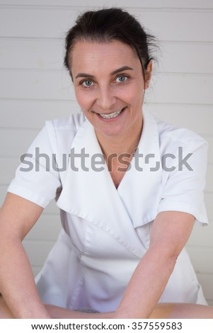 Portrait of beautician in a beauty center - stock photo