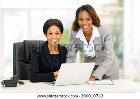 portrait of beautiful african american business women in office - stock photo