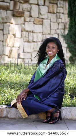 portrait of Beautiful African-American graduate - stock photo