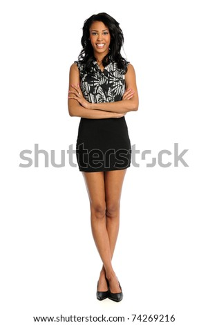 Portrait of beautiful African American woman standing over white background - stock photo
