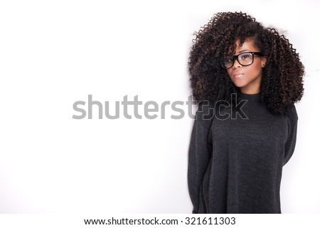 Portrait of beautiful african american young girl. Girl with afro and eyeglasses. - stock photo
