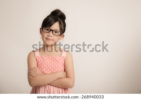 Portrait of beautiful asian girl wearing glasses - stock photo