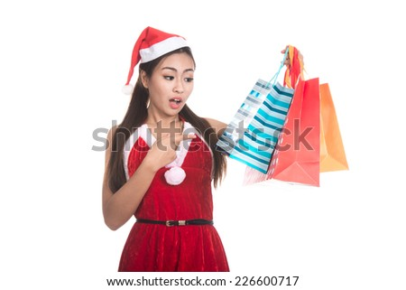 Portrait of beautiful Asian woman wearing Santa Claus clothes with holding shopping bags,christmas,x-mas,winter,happiness concept,Human face expressions,Positive emotions,isolated on white background  - stock photo