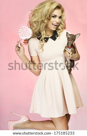 Portrait of beautiful attractive blonde woman looking at camera. - stock photo