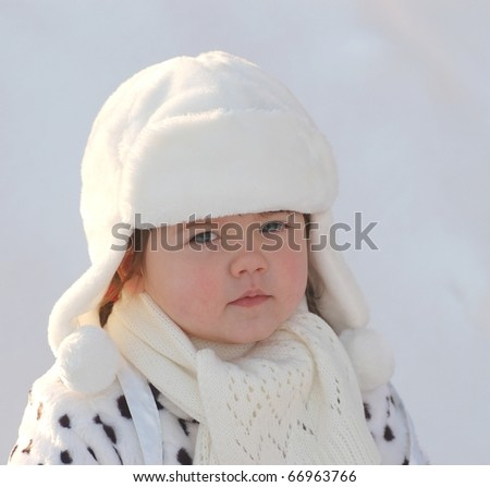 Portrait of beautiful baby girl in winter time - stock photo