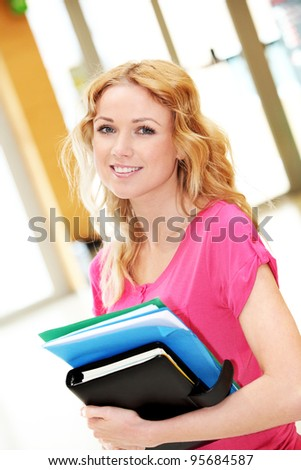 Portrait of beautiful blond girl at university - stock photo