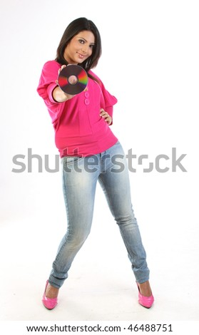 portrait of beautiful blond girl holding CD or DVD - stock photo