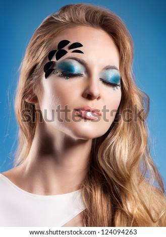 Portrait of beautiful blond girl with sea make up - stock photo