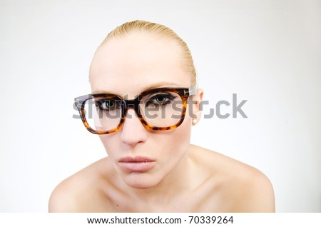 portrait of beautiful blond woman in glasses posing on white - stock photo