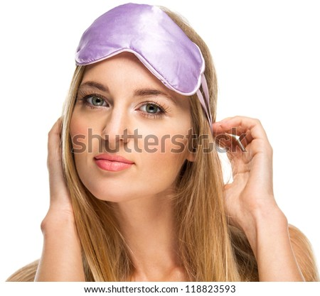 Portrait of beautiful blond woman wearing a sleeping mask - stock photo