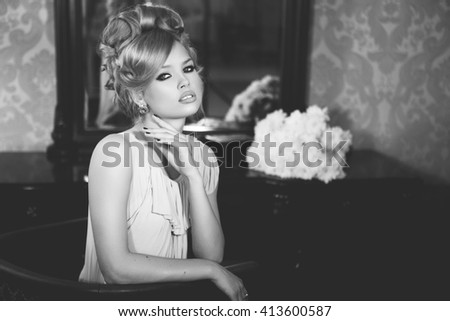 Portrait of Beautiful Blond Woman with Long Hair and Clean Skin. Brigitte Bardot look. Perfect Make-Up and Coiffure - stock photo