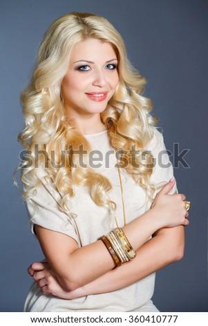 Portrait of beautiful blonde woman. beautiful blonde woman with perfect curly hair. Blonde Hair. Portrait of Beautiful Woman with Long Wavy Hair. High quality image. - stock photo