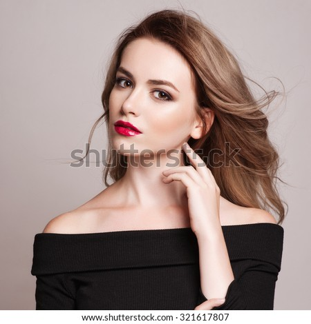 Portrait of beautiful blonde woman with curly hairstyle and bright makeup.  Natural look. studio, isolated. - stock photo