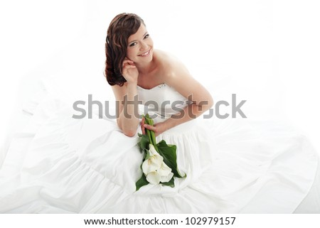 Portrait of beautiful bride sitting on the retro char outdoors - stock photo
