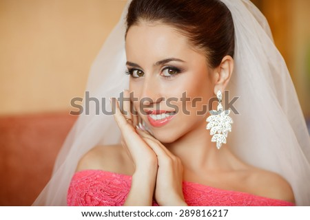 Portrait of beautiful Bride with wedding makeup and elegant hairstyle, happy marriage woman in wedding day at home, wedding girl with jewelry and bridal accessories, series. - stock photo