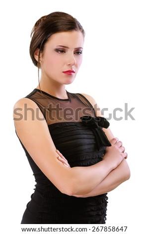 portrait of beautiful brunette girl posing in black dress on white - stock photo