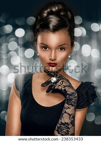 Portrait of beautiful brunette smart woman wearing gloves and ring with big stone. - stock photo