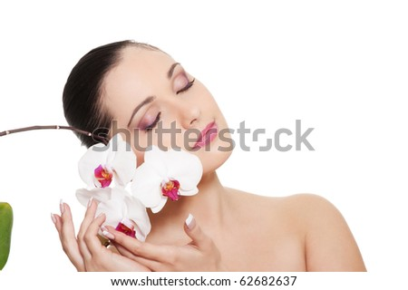 portrait of beautiful brunette with orchid over white background - stock photo