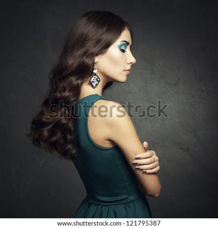 Portrait of beautiful brunette woman in green dress. Fashion photo - stock photo
