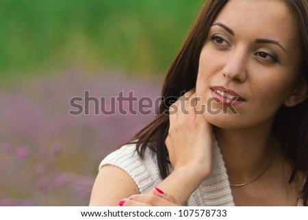 portrait of beautiful brunette young woman outdoor - stock photo