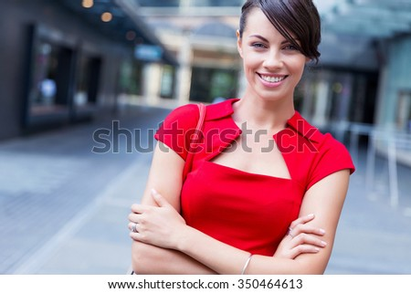 Portrait of beautiful business woman in red dress - stock photo