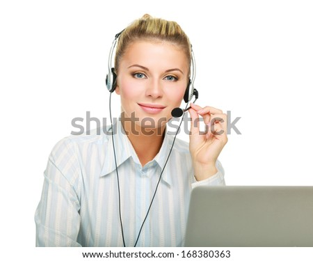 Portrait of beautiful business woman working at her desk with headset and laptop - stock photo