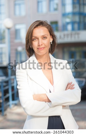 Portrait of beautiful businesswoman posing for camera outdoor - stock photo