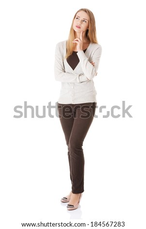 Portrait of beautiful casual woman thinking. Isolated on white. - stock photo
