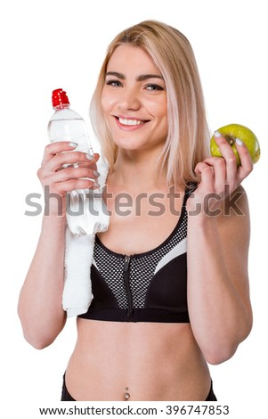 Portrait of beautiful caucasian blonde sporty woman. Young athlete smiling, holding green apple and bottle of water, looking at camera. Isolated on white background - stock photo