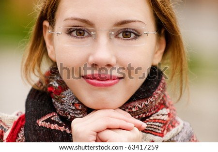 Portrait of beautiful charming smiling woman - stock photo