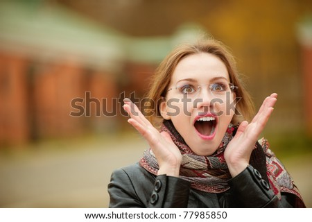 Portrait of beautiful charming woman in shock. - stock photo