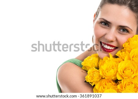 Portrait of beautiful cheerful woman with a bouquet of roses - stock photo