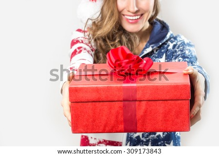 Portrait of Beautiful Christmas Woman hold christmas gift box, focus on box - stock photo