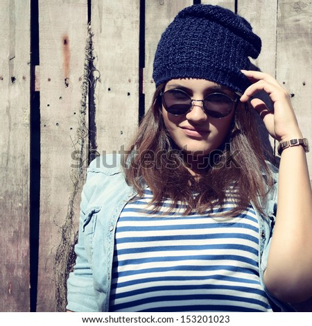 portrait of beautiful cool girl in hat and sunglasses - stock photo