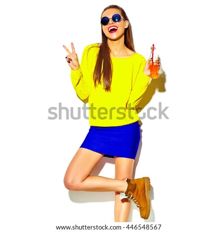 portrait of beautiful crazy smiling brunette woman girl in casual hipster summer colorful clothes with red lips isolated on white drinking soda from bottle with straw in sunglasses  - stock photo