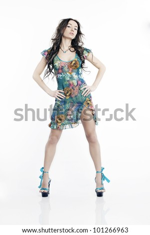 Portrait of beautiful dancing woman with long legs in a dress on a white background - stock photo
