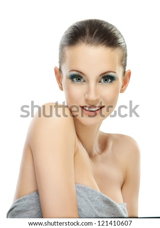 Portrait of beautiful dark-haired smiling woman in gray dress, isolated on white background. - stock photo