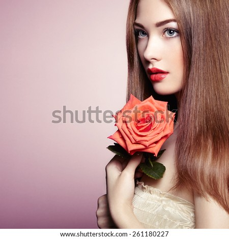 Portrait of beautiful dark-haired woman with flowers. Perfect makeup. Brunette girl. Fashion photo - stock photo