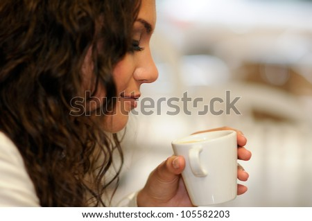 Portrait of beautiful elegant woman with coffee cup - stock photo