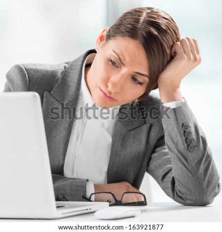 Portrait of beautiful executive working on computer at office - stock photo