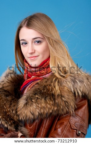 Portrait of beautiful female in sheepskin coat with fur collar - stock photo