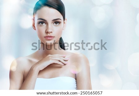 Portrait of beautiful female model / photoset of attractive brunette girl on blurred blue background with bokeh  - stock photo