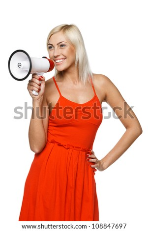 Portrait of beautiful female proclaiming into the loudspeaker to the side, isolated on white background - stock photo