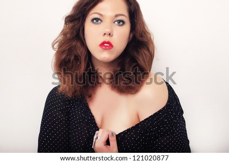 portrait of beautiful feminine plus size curly young  woman - stock photo