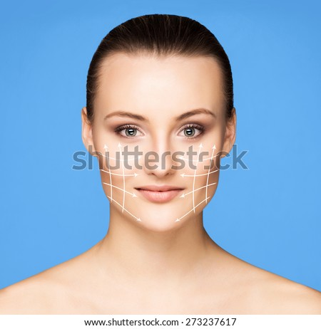 Portrait of beautiful, fresh, healthy and sensual girl. Arrows on the face. - stock photo