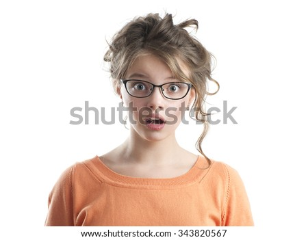 Portrait of beautiful frightened girl. Studio photography on a white background. Age of child 10 years. - stock photo